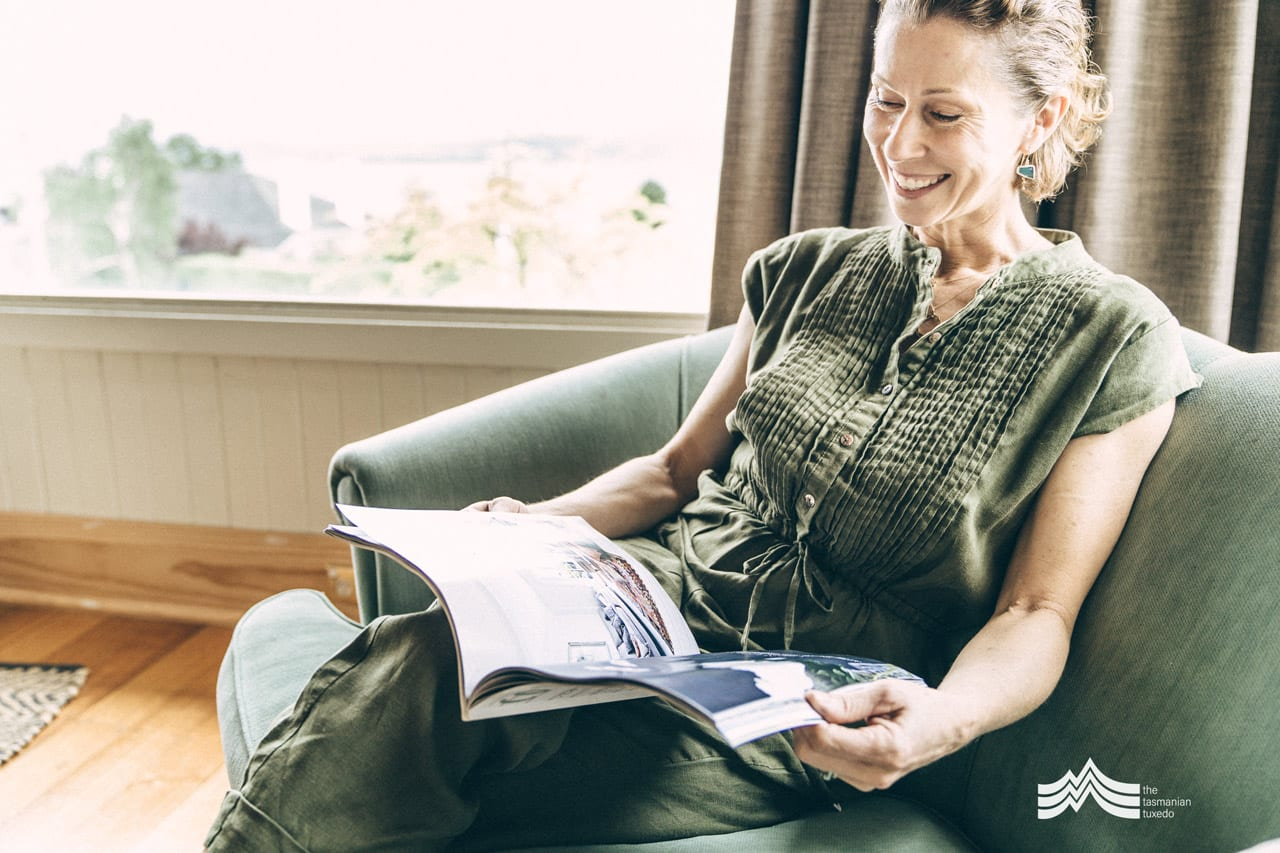 Tonya Gilbett relaxing on Sofa with a magazine
