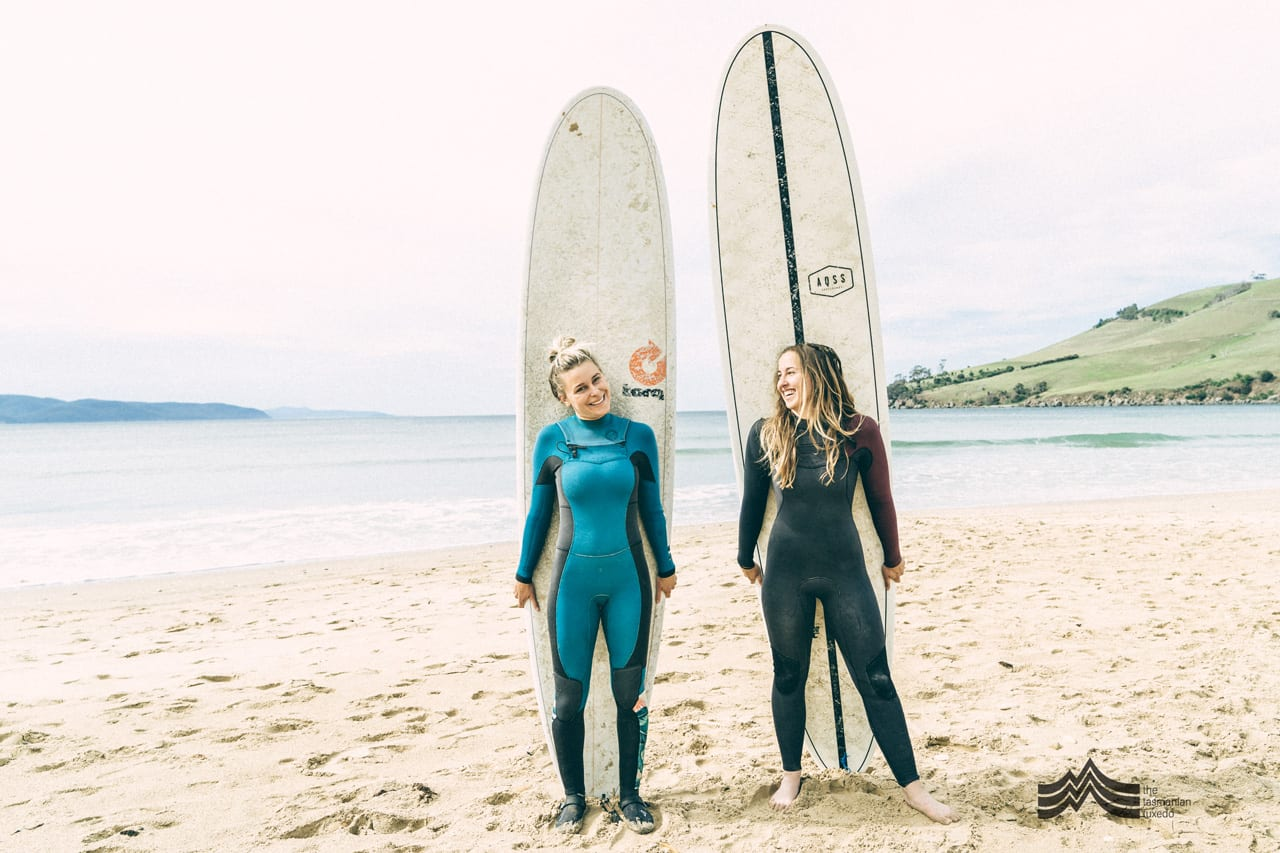 Brooke Mason and Friend Hahnee with Surfboards on beach in Tasmania