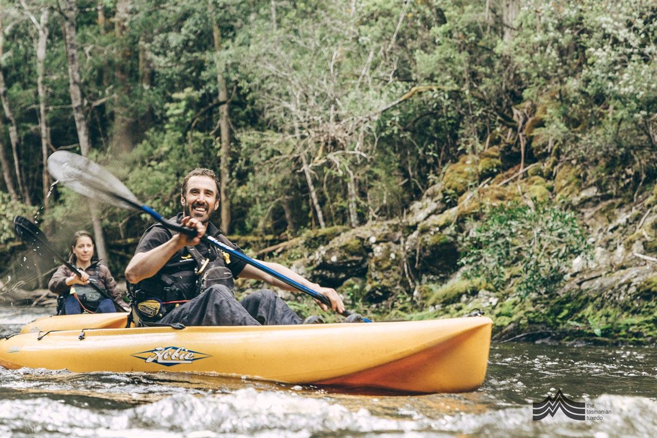 Liam from Tassie Bound kayaking down the river, Derwent Valley Tasmania