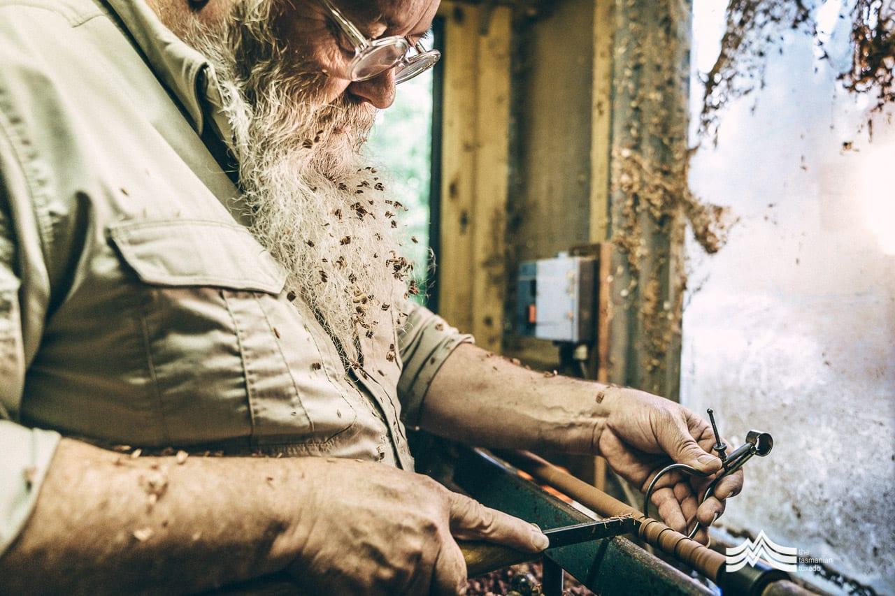 Jon Grant using wood lathe in his workshop