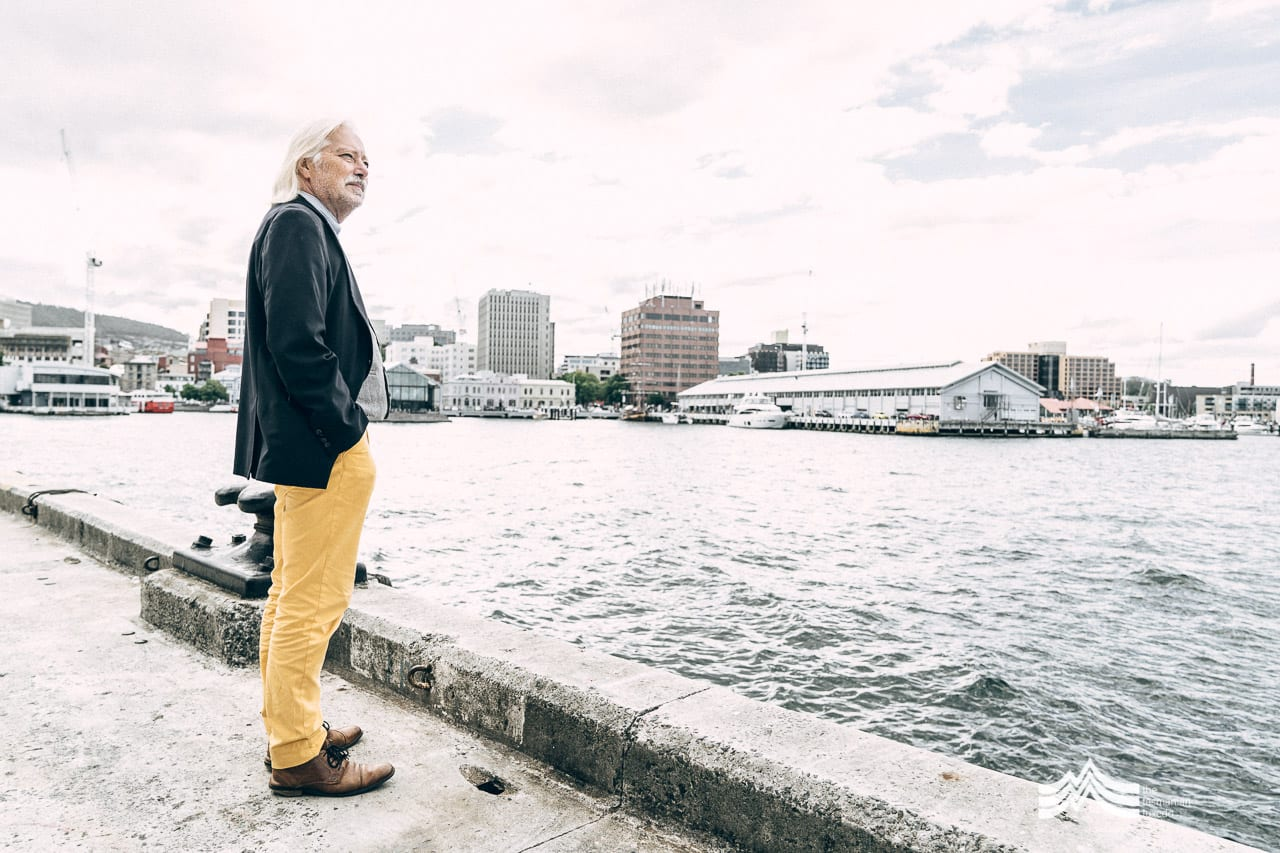 Gustaaf Hallegraeff standing in front of the Hobart waterfront
