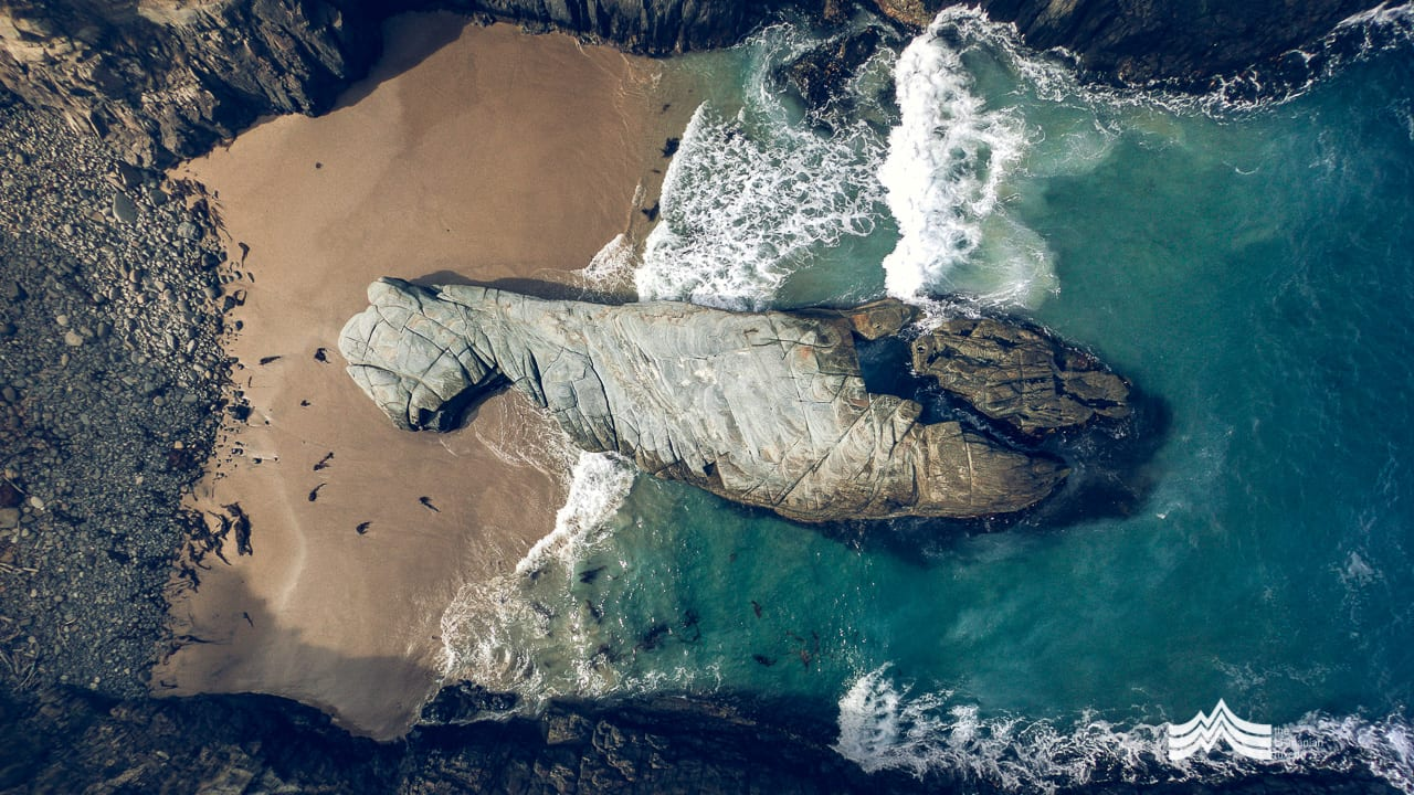Rock, water, sand from an aerial perspective, Remarkable Cave, Tasmania