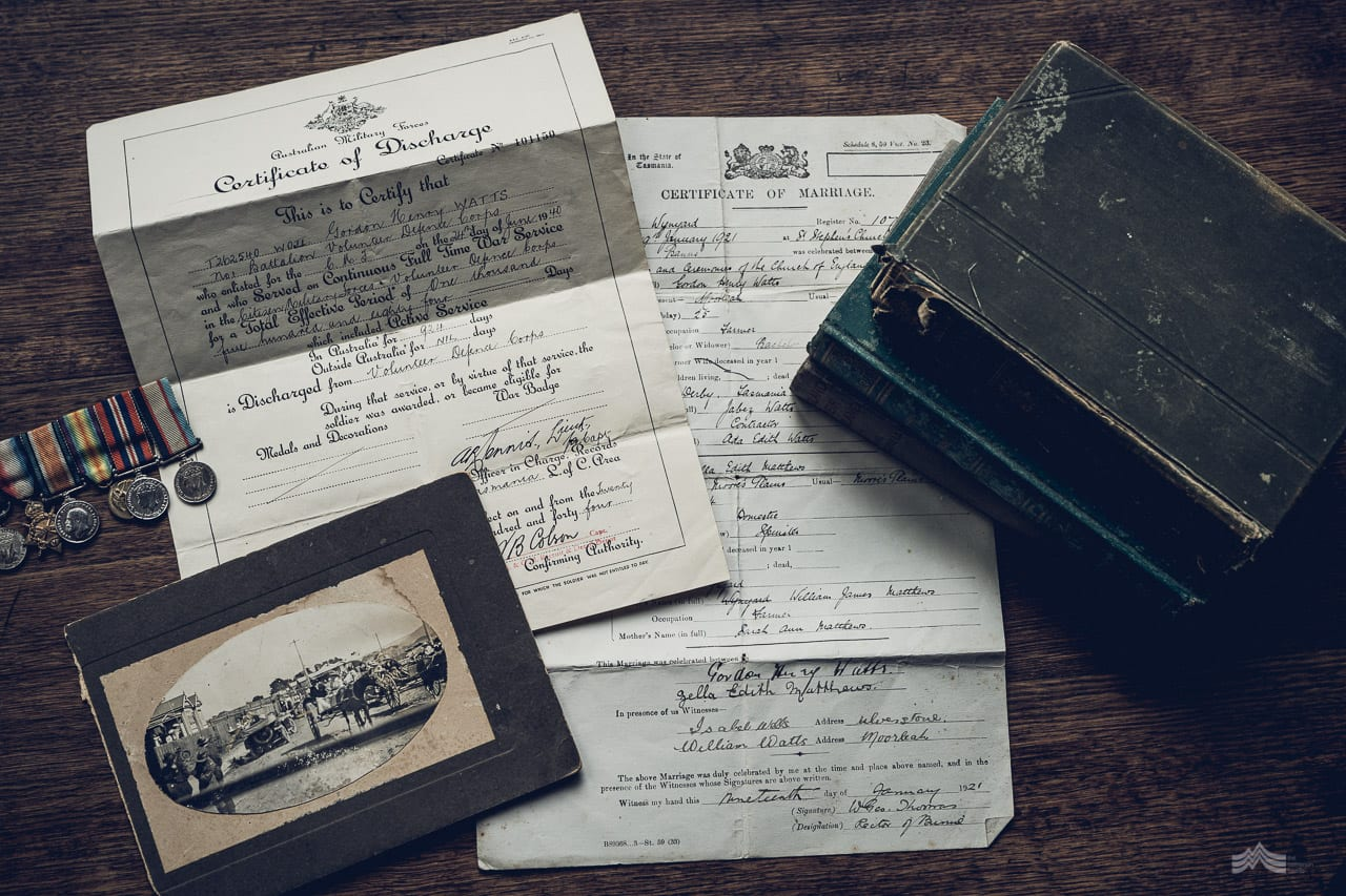 Collection of old war paperwork spread on table