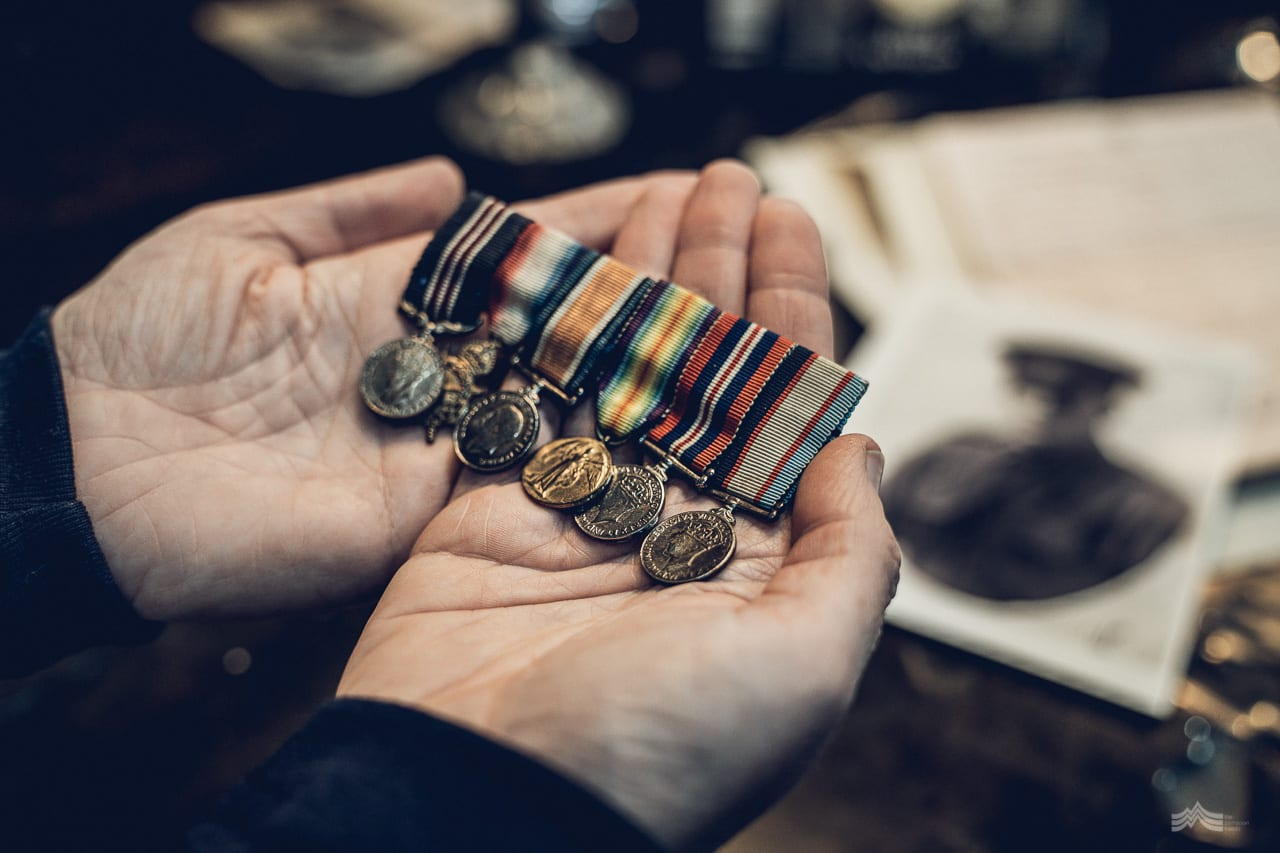 Gordon's medals being carefully held in a lady's hands